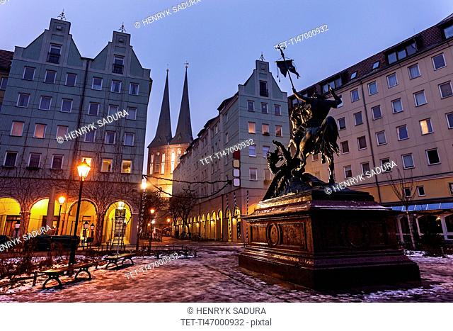 Equestrian statue on illuminated town square