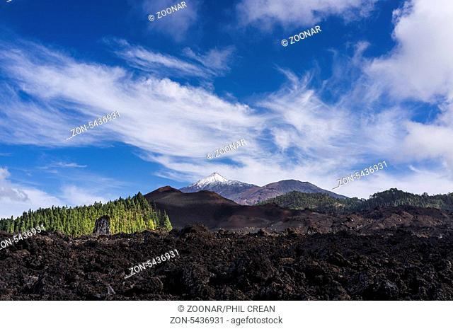 Lava flow near Chinyero and Teide with snow on in the national park of Las Canadas del Teide, Tenerife, Canary Islands, Spain