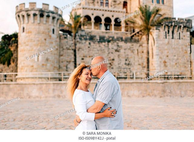 Couple hugging and kissing on beach, Estoril, Lisboa, Portugal