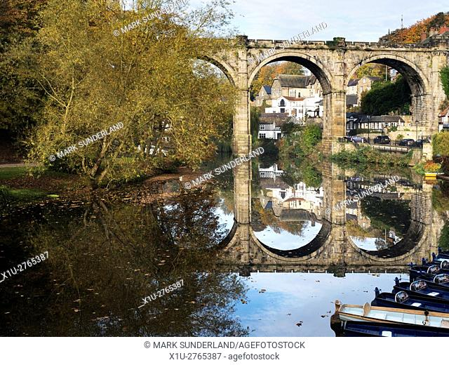 Railway Viaduct Reflected in the River Nidd in Autumn Knaresborough North Yorkshire England