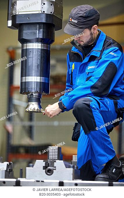 Technician adjusting lathe head with cutting tool, Vertical lathe, Machining Center, CNC, Design, manufacture and installation of machine tools, Gipuzkoa