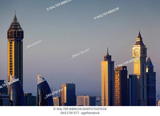 UAE, Dubai, Downtown Dubai, elevated view of skyscrapers on Sheikh Zayed Road from downtown, dusk