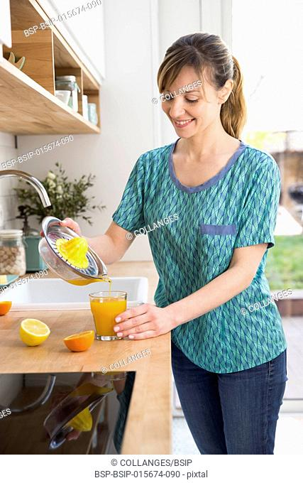 Woman preparing fresh fruit juice