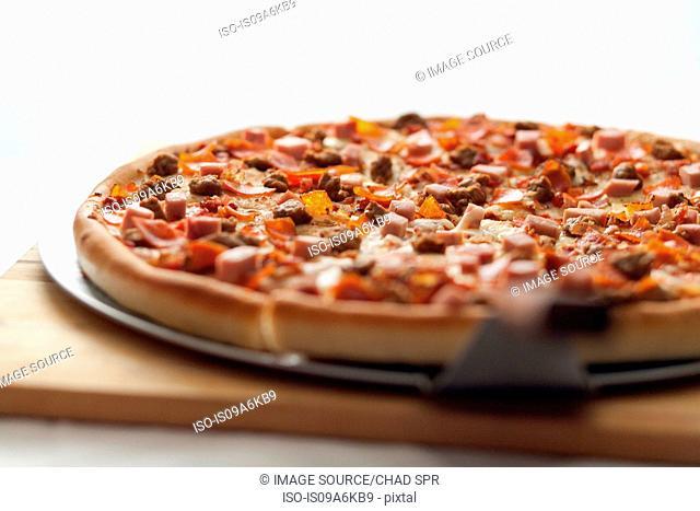 Close up of shovel and deep dish pizza