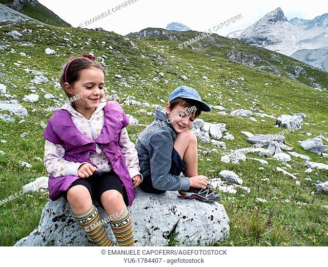Children on an excursion to the Valley of Vitelli, Stelvio National Park, Bormio, Lombardy, Italy