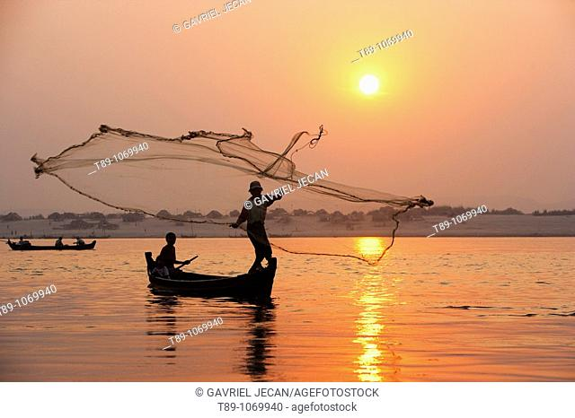 Fisherman Fishing with net at sunset, Mandalay, Myanmar