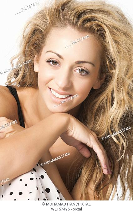 Beautiful young woman smiling against a white background