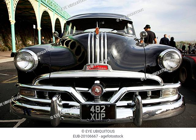 Old American Pontiac automobile on Madeira Drive during classic car festival