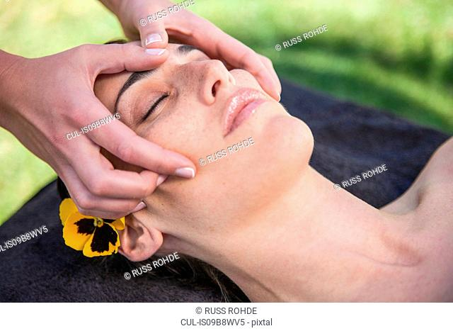 Woman in spa environment, having facial treatment