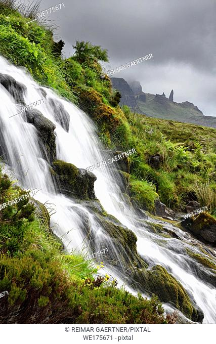Bride's Veil WaterFalls to Loch Leathan at The Storr with Old Man of Storr peak in clouds on Isle of Skye Inner Hebrides Scotland UK