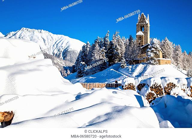 The church of San Gian in winter, Celerina, Engadine, Canton of Grisons Switzerland Europe