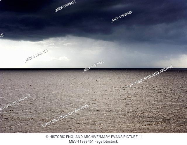 Seascape. View from Birnbeck Pier, Weston Super Mare, Somerset. Grey overcast sky. Line on the horizon