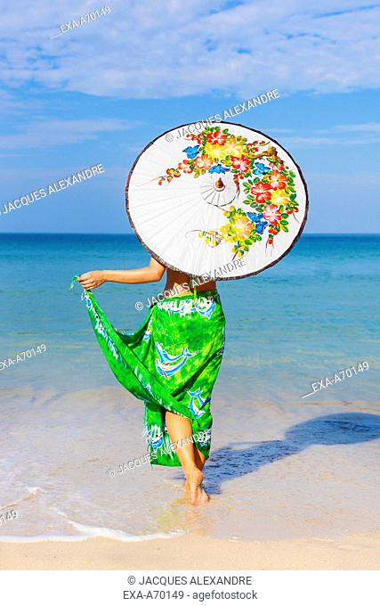 woman at beach with umbrella