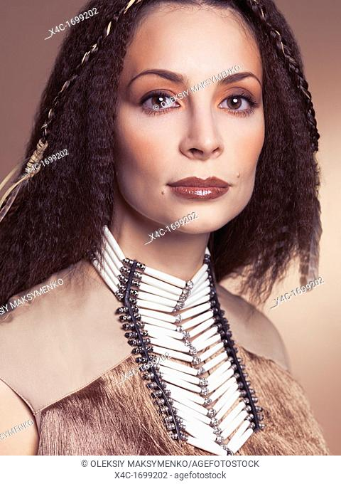 Artistic beauty portrait of a beautiful woman wearing aboriginal native necklace and accessories