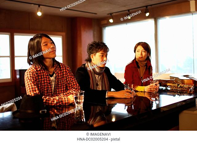 Young people relaxing in a bar