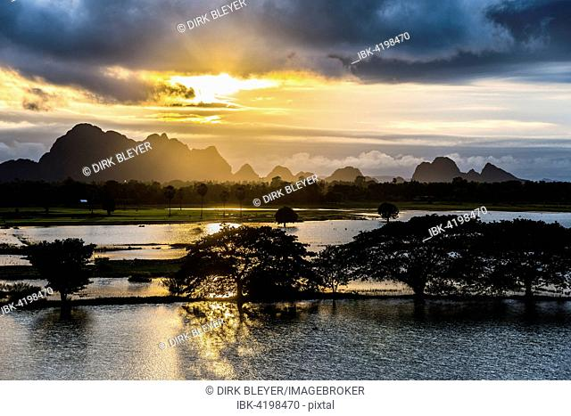 Sunset above tower karst mountains, artificial lake, landscape in the evening light, Hpa-an, Karen or Kayin State, Myanmar