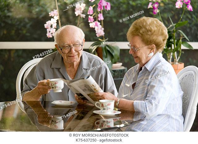 Senior couple having coffee or tea together
