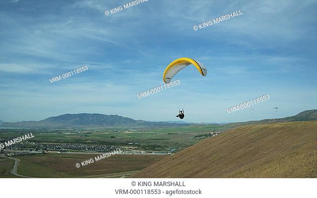 WS PAN POV Person paragliding mid-air / Lehi, Utah, USA