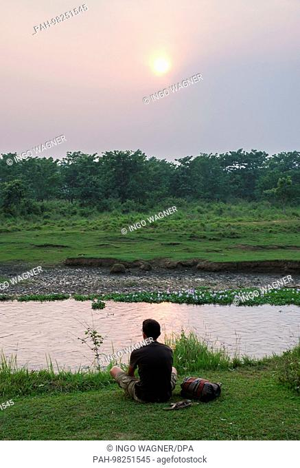 Evening at the river through the Chitwan National Park in the south of Nepal. | usage worldwide. - Chitwan/Nepal