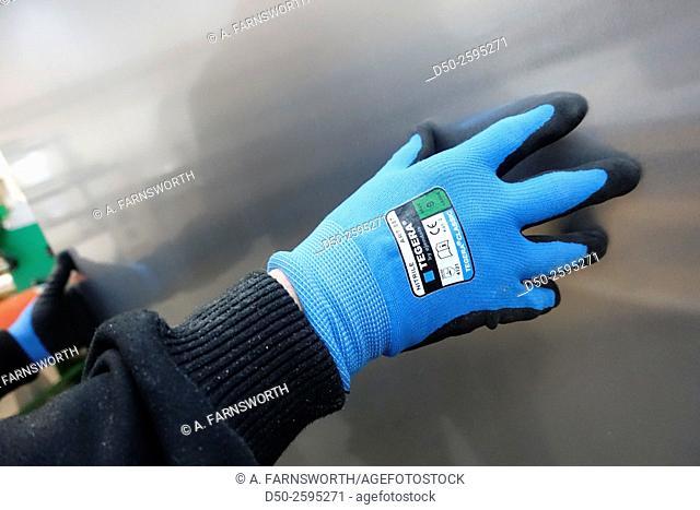 STOCKHOLM, SWEDEN Print shop employee, glove and aluminium