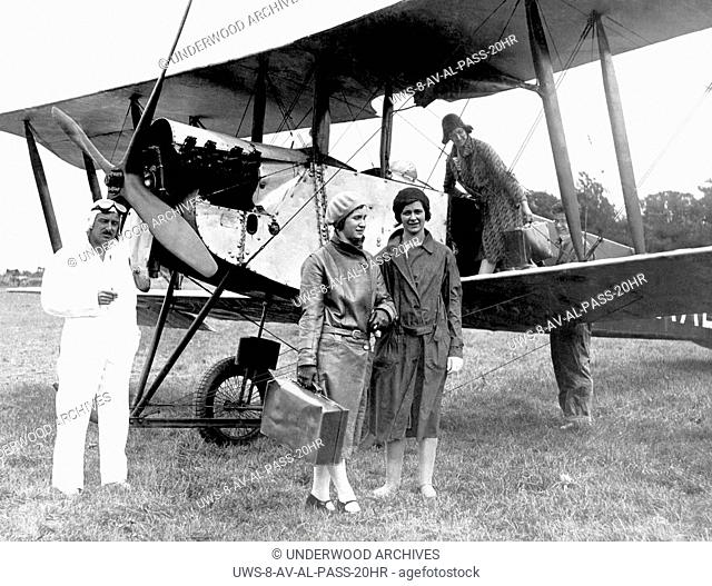 Hildenborough, England: c. 1924.Three women passengers arriving in a biplane passenger service