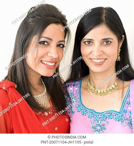 Portrait of a mature woman smiling with her daughter