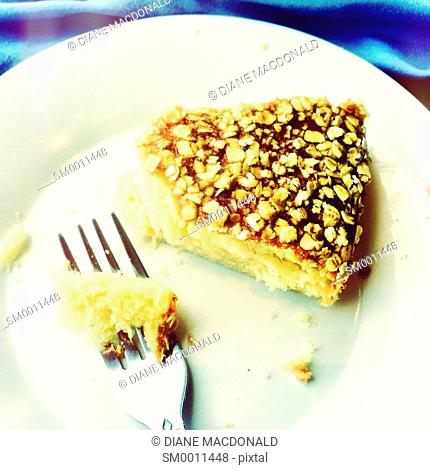 Cake with oatmeal flakes and fork
