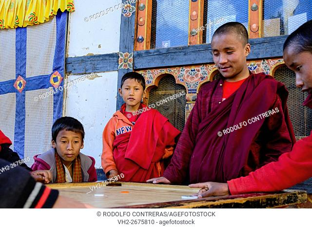 Novice monks playing at the monastery in Bhutan.