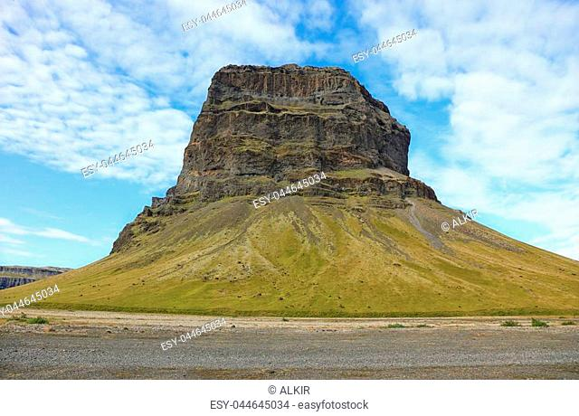 Landscape with mountain Lomagnupur in the countryside in Iceland between Vik and Jokulsarlon