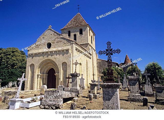 France, Dordogne region, village of Montpeyroux, 12 century Romanesque church, graveyard, chateau in background