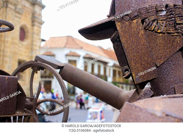 Sculpture representing a flavored ice seller in the Plaza de San Pedro Claver, in the ancient walled city of Cartagena de Indias. Bolivar, Colombia