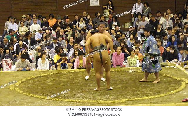 Sumo-themed comic performance before a sumo fight at Saitama, Saitama Prefecture