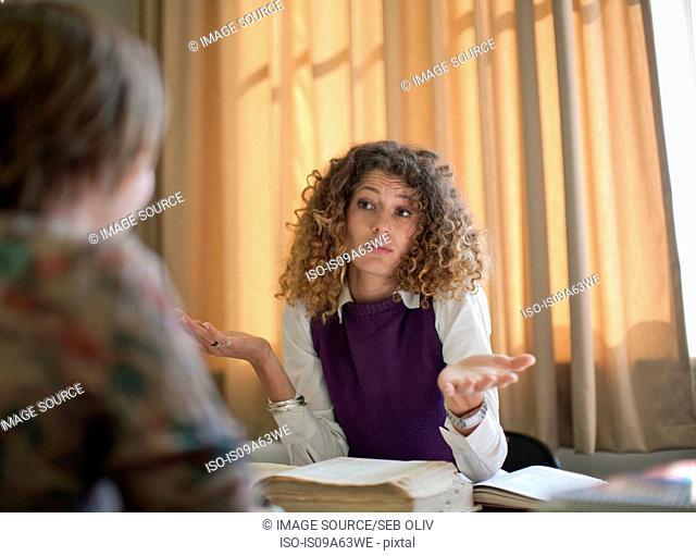 Student shrugging at desk