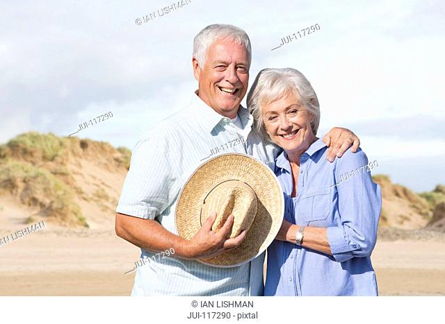 Portrait Of Mature Couple Enjoying Beach Vacation Together