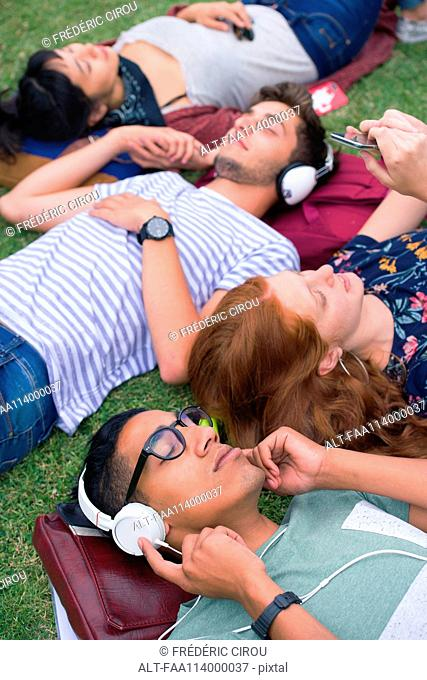 College students relaxing on grass between classes