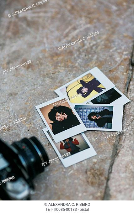 Polaroid photographs of young woman by camera
