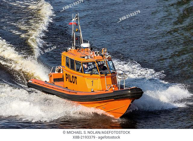 Pilot boat underway in the Sea Port of St. Petersburg, on the Neva River, Russia