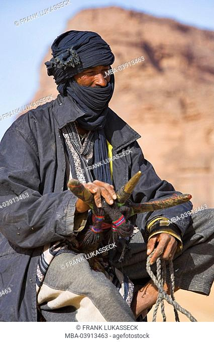 Africa, Libya, Jabal Akakus, Tuareg, rding a camel, portrait