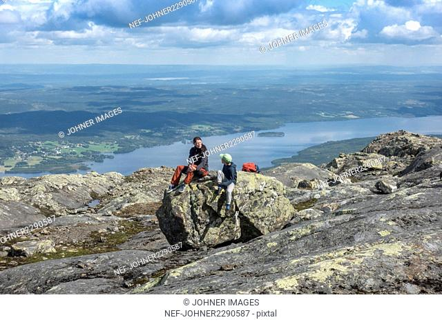 Mother and son resting in mountains