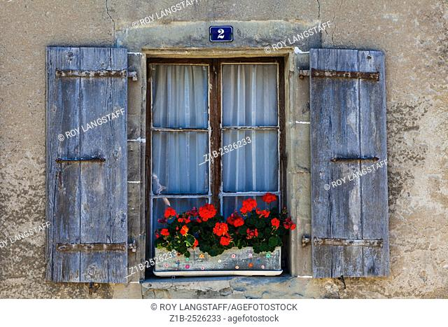 Faded shutters and an old window in a building in the town of Nyon, Switzerland