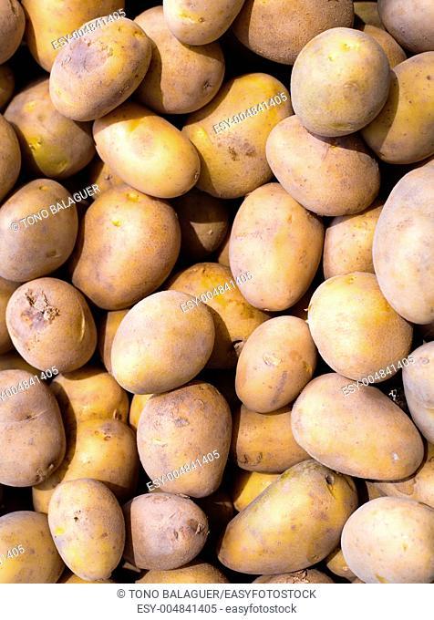 Brown potatoes pattern in a market display in mediterranean