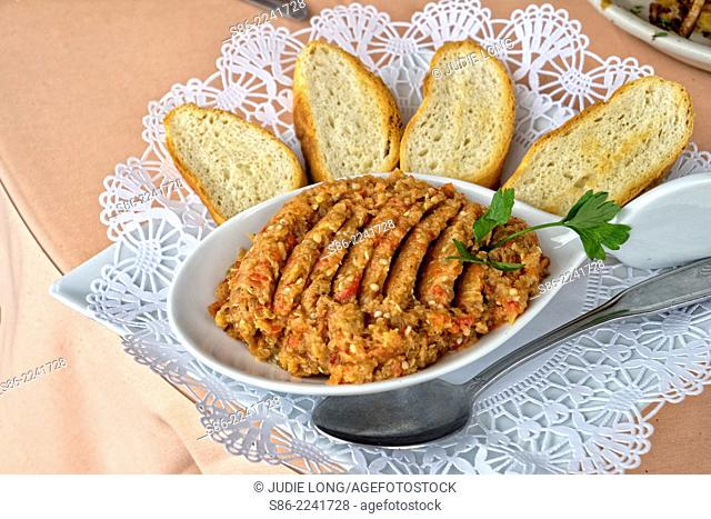Eggplant 'Caviar', Russian Style. Eggplant Odessa Style in a Serving Bowl, Surrounded by Toasted Bread Slices. Served in Brighton Beach, Brooklyn, New York