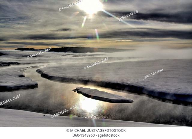 Steam and sun surround Alum Creek in the Hayden Valley at Yellowstone National Park,Wyoming