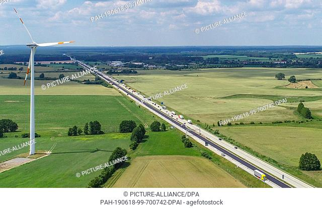 17 June 2019, Brandenburg, Biegen: The motorway BAB 12 near the junction Müllrose, view in west direction, aerial view with a drone