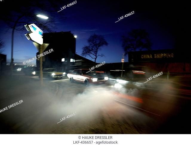 Modern classic cars in harbor area at night, Motoraver group, Hamburg, Germany