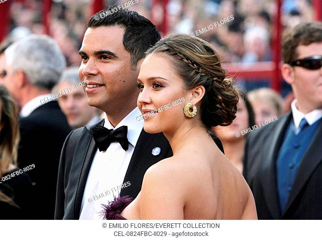 Cash Warren, Jessica Alba (wearing Cartier earrings) at arrivals for RED CARPET - 80th Annual Academy Awards Oscars Ceremony, The Kodak Theatre, Los Angeles, CA