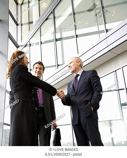 A businessman greeting clients