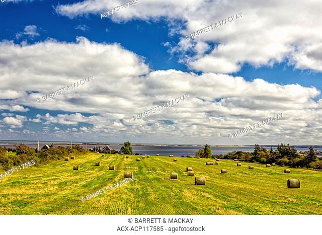 Baled hay and farmhouse, Springbrook, Prince Edward Island, Canada