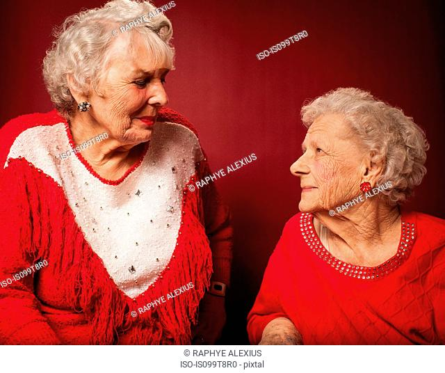 Two senior women looking at each other