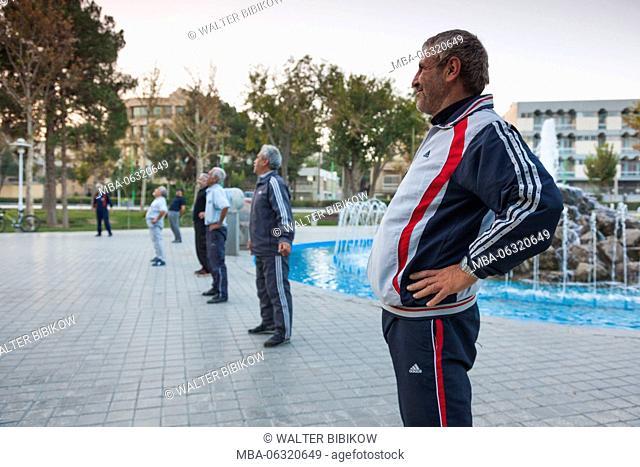 Iran, Central Iran, Esfahan, older men excercising by the river